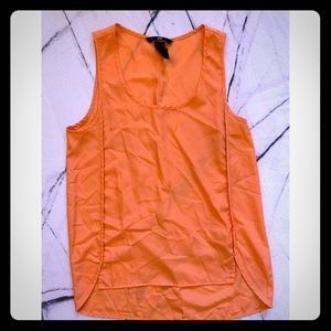 Orange sleeveless blouse